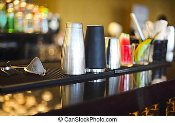 Bar counter with bottles in blurred background