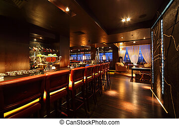 bar counter with chairs in empty comfortable restaurant at...