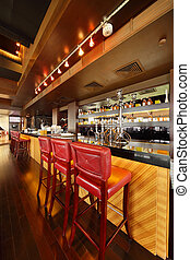 bar counter with chairs in empty comfortable restaurant; wide range of hookahs and drinking