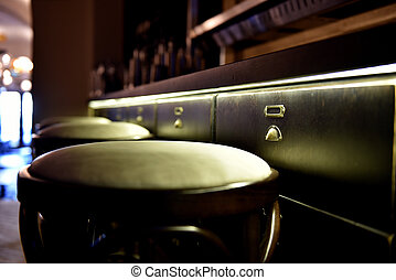 Bar counter with high chairs in cosy restaurant