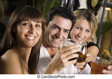 bar - healthy living: friends at a restaurant having fun...