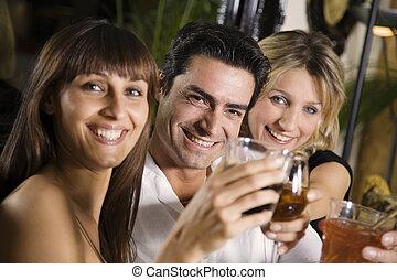 bar - healthy living: friends at a restaurant having fun...