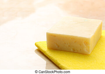 Bar of soap and duster on tile