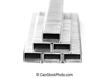 bar of staples arranged on a white background
