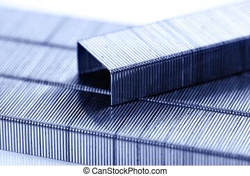 bar of staples arranged on staples background
