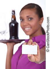 Bar owner showing business card
