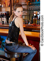 Girl having a beer in a bar