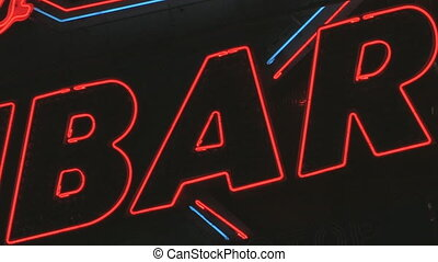 Red and white flashing sign reading %u2018BAR%u2019. Neon and lightbulbs. Shot with Canon XH-A1s.
