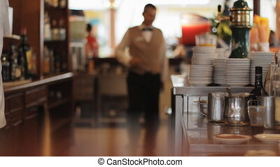 Bar - Very Busy Bar Staff In A Hotel Making Cappuccino...