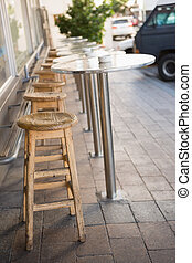Bar stool and tables on the terrace