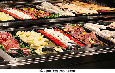 bar with tray filled with tomato and vegetable salami...