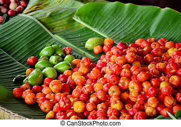 Barbados cherry fruits sale at market in Thailnad.