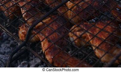 Barbecue Chicken. chicken's wings are roasted on the grill. slow motion