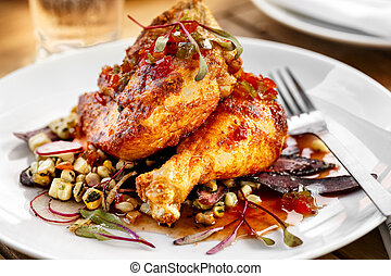 Barbecue Chicken - Close-up of plated barbecue chicken at an...