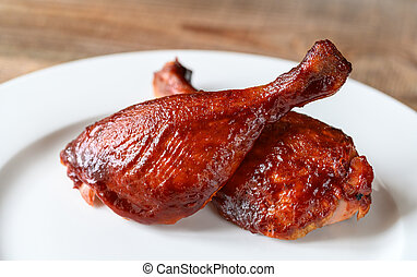 Barbecue duck legs served on white plate