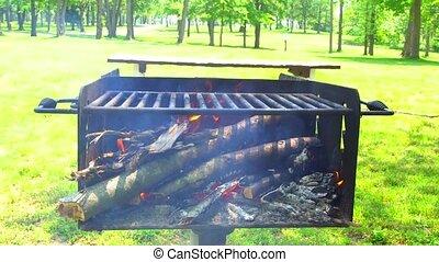 Barbecue fire, bonfire, wood burning.