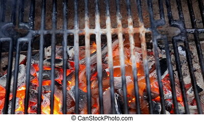 barbecue grid against flames from charcoal, food background...
