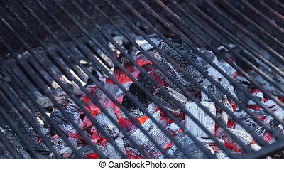 Barbecue Grill - Empty barbecue grill with burning charcoal...