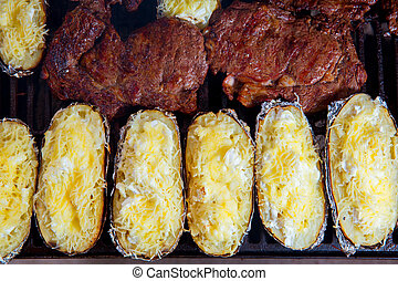 Barbecue grilled beef meat and prepared potatoes