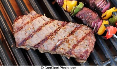 Barbecue. Grilled steak and shish kebab, on hot grill