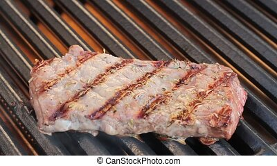 Barbecue. Grilled steak, on hot grill. ( 1080p HD video...