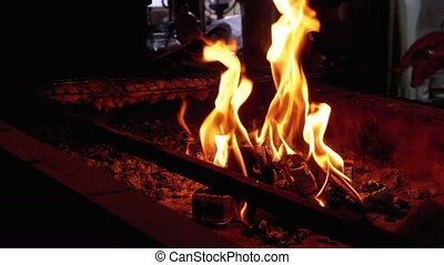 Barbecue is Cooked by the Fire on the Grill in a Restaurant...