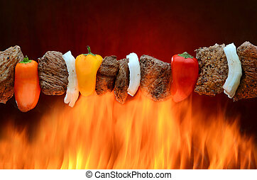 Barbecue Kabob over Fire - Skewered meat and vegetable kabob...