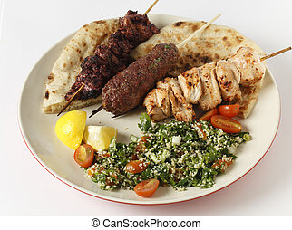 Barbecue kebab plate with tabouleh - Various barbecued...