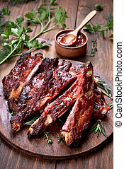 Barbecue meat, grilled sliced pork ribs on wooden board