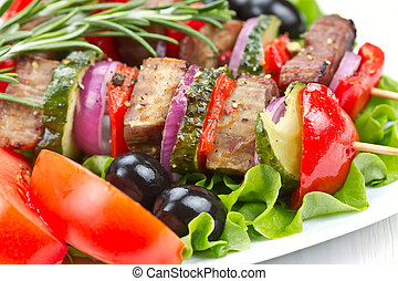 Barbecue meat on skewers with vegetables - Barbecue meat on...