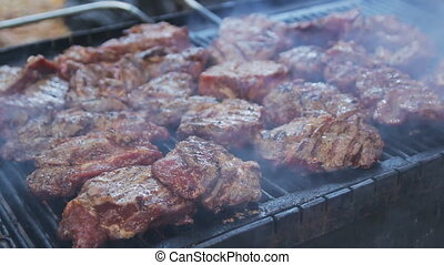 Barbecue meat preparing on grill, close up. Mutton or pork...