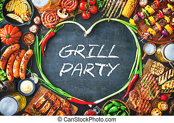 Grilled meat and vegetables on rustic stone plate