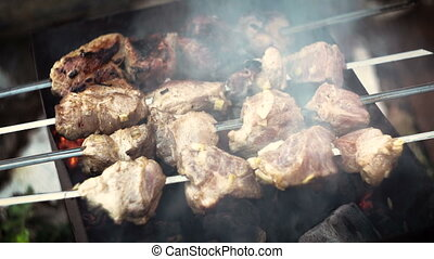 Barbecue of meat roasted on charcoal