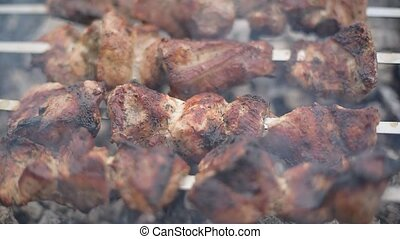 Barbecue or shish kebab is fried on the grill. - Barbecue or...