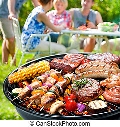 Barbecue party - Family having a barbecue party in their...