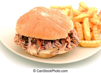 barbecue pulled pork sandwich and fries