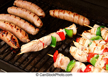 Barbecue - Sausages and chicken kebabs on a barbecue