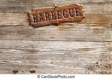 barbecue signboard nailed to a wooden panel