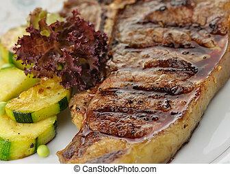 barbecue T Bone steak close up - fresh and juicy t-bone...
