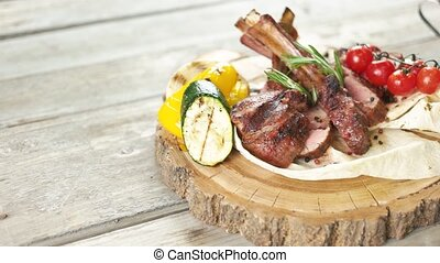 Barbecue veal ribs. Meat, pita bread and vegetables.