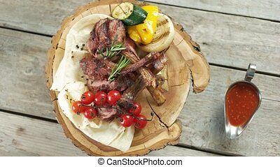 Barbecue veal with vegetables. Tasty dish and sauce.