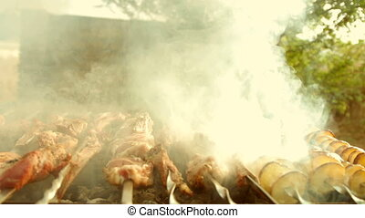 Barbecue With Delicious Grilled Meat and potatoes On Grill....