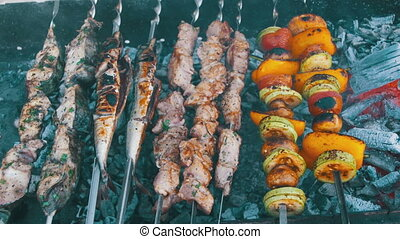 Barbecue with Delicious Grilled Meat and Vegetables Cooked on the Grill