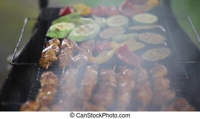 Barbecue With Delicious Grilled Meat On Grill. Closeup