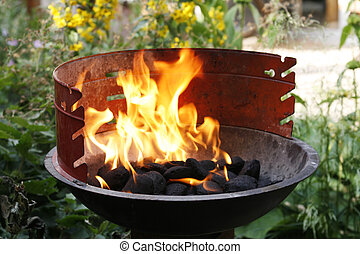 Barbecue with flames - Golden red flames in barbecue ...