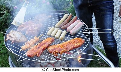 barbecue with meat and sausage