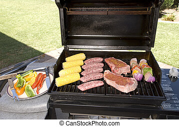 Barbecue with steaks, brats chicken and corn