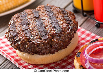 Barbecued Hamburger - A juicy barbecued hamburger with grill...