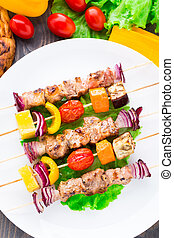 Barbecued pork and vegetable kebabs