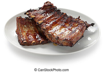 barbecued pork spare ribs - a rack of cooked pork spare ribs